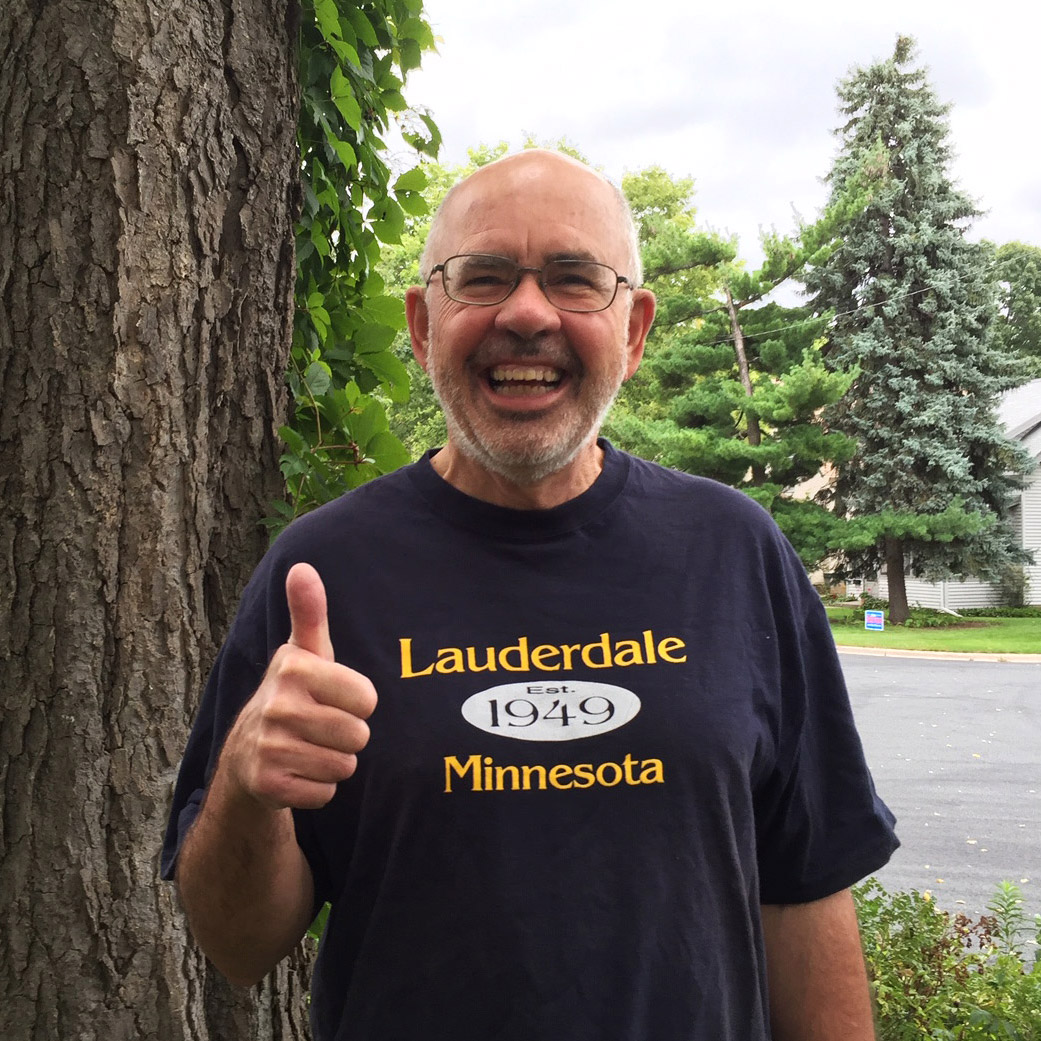 Jeffrey Dains smiling and giving a big thumbs up while wearing his Lauderdale Minnesota T-Shirt